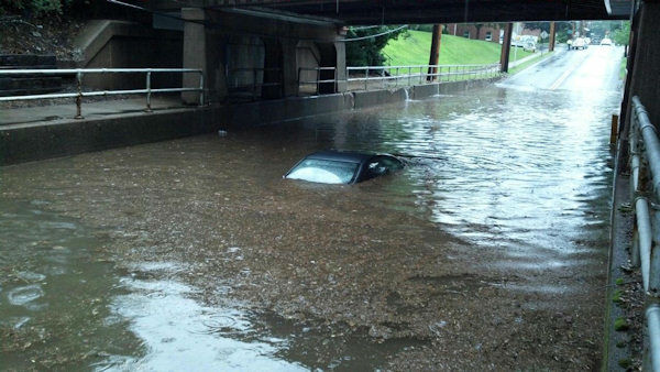 A car trapped in flood waters on Maple Avenue in Glen Rock. (Ernie Mickens)