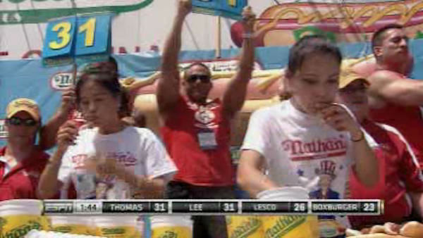 "<div class=""meta image-caption""><div class=""origin-logo origin-image ""><span></span></div><span class=""caption-text"">Joey Chestnut downed 69 franks to win his seventh straight Coney Island hot dog eating contest, while Sonya Thomas, known as the ""Black Widow"", won the women's competition. </span></div>"