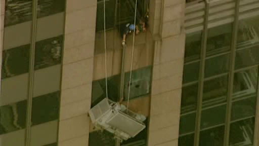 Photos from a scaffolding rescue in Midtown, where two workers found themselves hanging perilously at the 42nd floor above 6th Avenue and 46th Street.
