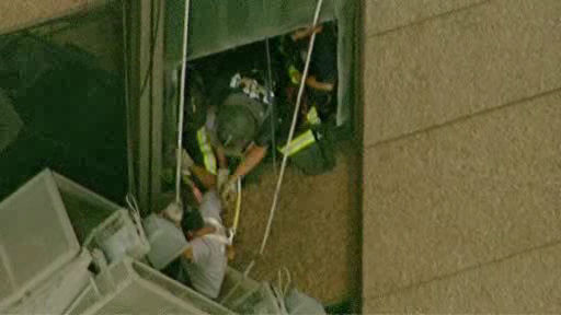 "<div class=""meta image-caption""><div class=""origin-logo origin-image ""><span></span></div><span class=""caption-text"">Photos from a scaffolding rescue in Midtown, where two workers found themselves hanging perilously at the 42nd floor above 6th Avenue and 46th Street.</span></div>"