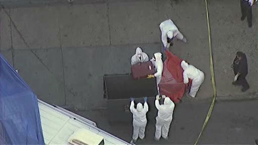"<div class=""meta image-caption""><div class=""origin-logo origin-image ""><span></span></div><span class=""caption-text"">At about 6:45 a.m., an NYPD crime unit carted away the trash bin and put it in a truck, and police officers walked in a line looking for evidence under cars and on sidewalks.   (WABC Photo)</span></div>"