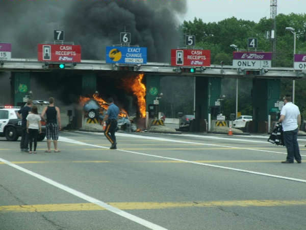 "<div class=""meta ""><span class=""caption-text "">A car erupted into flames after crashing into the Bergen Toll Plaza on the Garden State Parkway. (Photo/Stan Tomlinson)</span></div>"