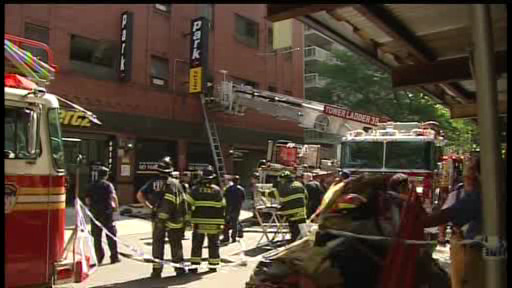 Rescuers pulled a driver from a vehicle that plunged down an elevator shaft at a parking garage on the Upper East Side on July 17, 2012.