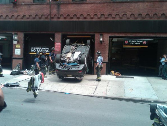 "<div class=""meta ""><span class=""caption-text "">Rescuers pulled a driver from a vehicle that plunged down an elevator shaft at a parking garage on the Upper East Side on July 17, 2012. (FDNY Photo)</span></div>"