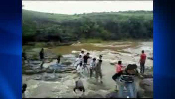 "<div class=""meta image-caption""><div class=""origin-logo origin-image ""><span></span></div><span class=""caption-text"">A picnic turned tragic for a family of five when a sudden and torrential wave caused by heavy rain swept them away at a waterfall in Patalpani in central India.  The entire incident was captured by an amateur photographer.  Two of the family managed to swim to safety, three others including 22-year-old cousins Chhavi and Modita and Modita's father Chandrashekhar drowned to death as the wave swept them away while they were enjoying at a waterfall in Patalpani. </span></div>"