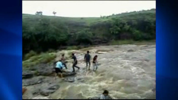 A picnic turned tragic for a family of five when a sudden and torrential wave caused by heavy rain swept them away at a waterfall in Patalpani in central India.  The entire incident was captured by an amateur photographer.  Two of the family managed to swim to safety, three others including 22-year-old cousins Chhavi and Modita and Modita's father Chandrashekhar drowned to death as the wave swept them away while they were enjoying at a waterfall in Patalpani.