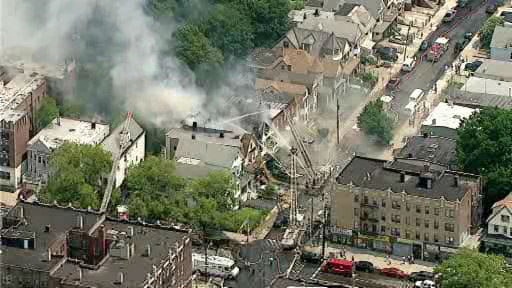 Firefighters battled a four-alarm fire in Jersey City on Friday, July 19, 2013. (NewsCopter 7)