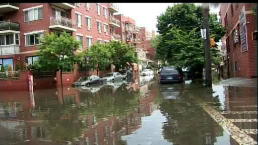 "<div class=""meta image-caption""><div class=""origin-logo origin-image ""><span></span></div><span class=""caption-text"">Pop-up showers and storms caused flooding in Flushing, Queens on Monday, July 22.</span></div>"