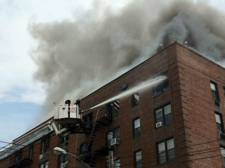 More than 200 firefighters battled a raging fire at a 7-story apartment building in Flatbush, Brooklyn.
