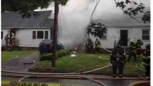 "<div class=""meta image-caption""><div class=""origin-logo origin-image ""><span></span></div><span class=""caption-text"">A small plane crashed into two homes in East Haven, Connecticut on Friday August 9, 2013.</span></div>"