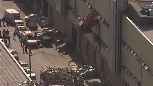 "<div class=""meta image-caption""><div class=""origin-logo origin-image ""><span></span></div><span class=""caption-text"">NewsCopter 7 over the scene where a sanitation truck crashed through the wall of a building in the Maspeth section of Queens on Wednesday morning. </span></div>"