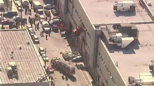 NewsCopter 7 over the scene where a sanitation truck crashed through the wall of a building in the Maspeth section of Queens on Wednesday morning.