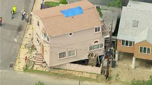"<div class=""meta image-caption""><div class=""origin-logo origin-image ""><span></span></div><span class=""caption-text"">A house on Locust Street in Highlands, Monmouth County slipped off a lift and into another house on Friday. The house was being lifted in order to be raised.  Fortunately, the other house was vacant. No one was injured. Officials are investigating what happened. </span></div>"