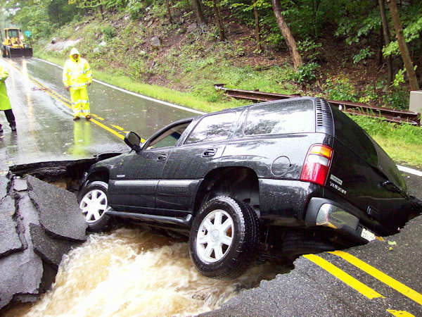 "<div class=""meta ""><span class=""caption-text "">The driver of this SUV was driving on Kinnelon Road in Kinnelon at 8:40 Sunday morning when the road collapsed.  The 39-year-old woman was able to escape the GMC Yukon and get a ride from another motorist.   (Photo/Kinnelon Police Department)</span></div>"