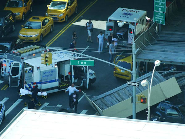 Four people suffered minor injuries when 2 vehicles, including a cab, crashed into scaffolding at 42nd and 1st on the East Side of Manhattan on Thursday, September 5, 2013.