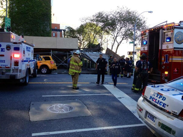 Four people suffered minor injuries when 2 vehicles, including a cab, crashed into scaffolding at 42nd and 1st on the East Side of Manhattan on Thursday, September 5, 2013. (NJ Burkett photo)