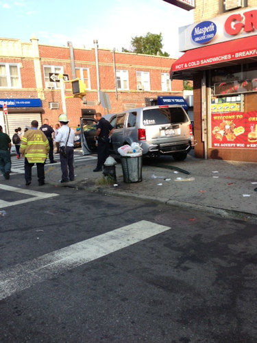 Photos from the scene where a Honda Pilot struck pedestrians outside of a school in Maspeth, Queens. (Ara Chekmayan)