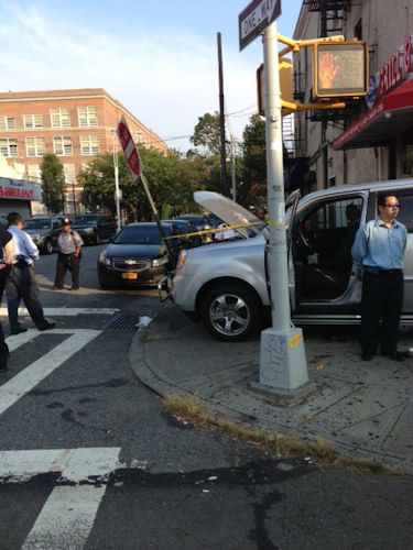 Photos from the scene where a Honda Pilot struck pedestrians outside of a school in Maspeth, Queens.(Ara Chekmayan)