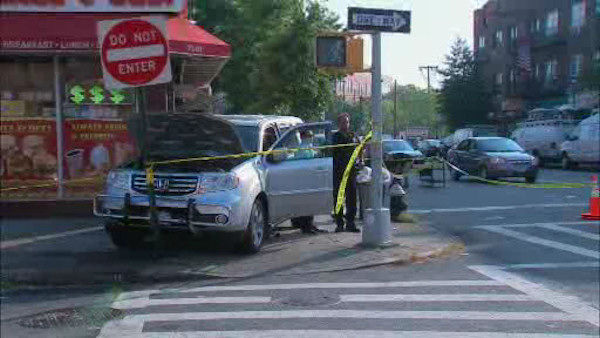 Photos from the scene where a Honda Pilot struck pedestrians outside of a school in Maspeth, Queens.
