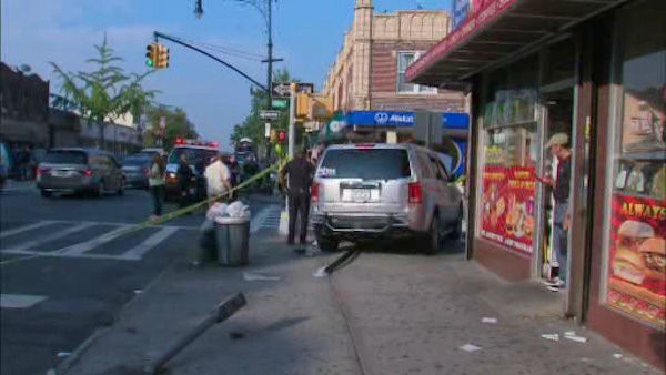 "<div class=""meta image-caption""><div class=""origin-logo origin-image ""><span></span></div><span class=""caption-text"">Photos from the scene where a Honda Pilot struck pedestrians outside of a school in Maspeth, Queens.</span></div>"