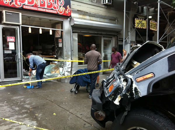 "<div class=""meta ""><span class=""caption-text "">8 people suffered injuries when a black Hummer hit a city bus, jumped the curb and struck the front of the Rub BBQ restaurant in Chelsea on Tuesday. </span></div>"