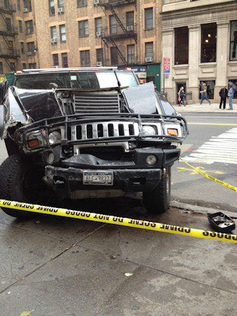8 people suffered injuries when a black Hummer hit a city bus, jumped the curb and struck the front of the Rub BBQ restaurant in Chelsea on Tuesday.  (Eyewitness News Viewer Photo)