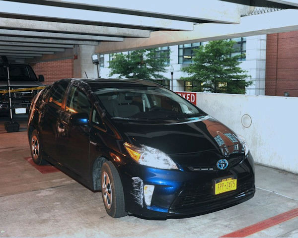 "<div class=""meta ""><span class=""caption-text "">Aaron Alexis? rental car, a blue Toyota Prius with New York plates, was located in Washington Navy Yard Parking Garage #28. (FBI)</span></div>"