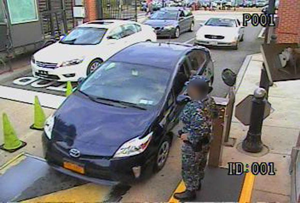 Alexis drives his rental car, a blue Toyota Prius, through the Washington Navy Yard main gate.  <span class=meta>(FBI)</span>