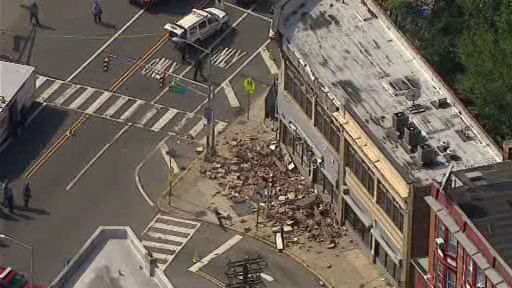 "<div class=""meta ""><span class=""caption-text "">Part of a commercial building came crashing down onto the sidewalk in Irvington.  A 30-foot piece of fa?ade came off the building around noon.  No one was injured. </span></div>"