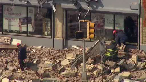 Part of a commercial building came crashing down onto the sidewalk in Irvington.  A 30-foot piece of fa?ade came off the building around noon.  No one was injured.