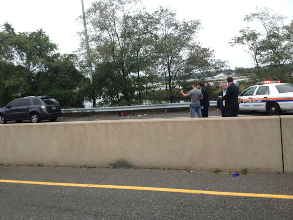 Photos from the scene near the Atlantic Beach Bridge where a Nassau County police officer was seriously injured in an accident on Oct. 2, 2012. (iWitness viewer photo)