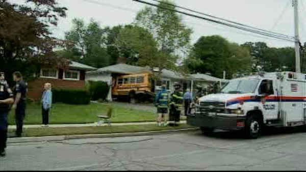 A small school bus hopped a curb and ran into a house in Syosset, Long Island.