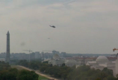 Helicopter flies over the National Mall following reports of gunshots near the Capitol.