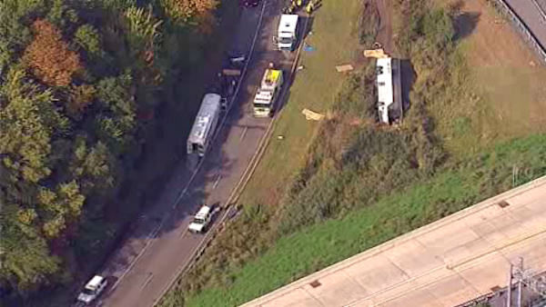 "<div class=""meta ""><span class=""caption-text "">A charter bus from Canada with 60 people on board overturned on a Rotue 80 exit ramp in Wayne, New Jersey.</span></div>"