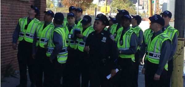 NYPD combs thru Long Island City for surveillance cameras in Avonte Oquendo search on Friday, October 18. (Stacey Sager)