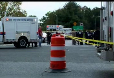 Photos from the scene where a Nassau County police officer and an innocent bystander were fatally shot along the Cross Island Parkway.