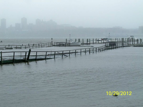 Von Dohln Marina in Edgewater, New Jersey. Docks are ripped off pilings.