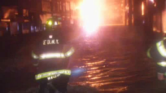 A fire erupted as flood waters rose in Rockaway Park, Queens on Monday night.