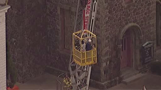 A third attempt from the ground using a cherry picker was successful in rescuing the men around 4:30 p.m.