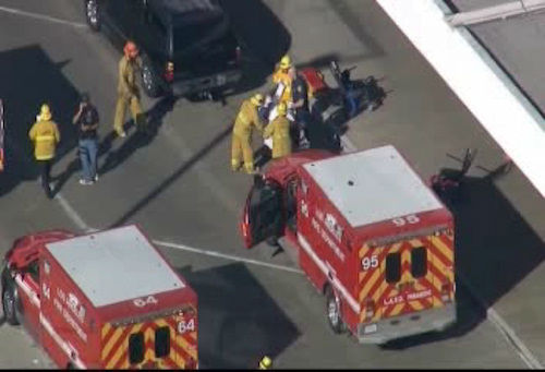 "<div class=""meta image-caption""><div class=""origin-logo origin-image ""><span></span></div><span class=""caption-text"">Scene outside LAX in Los Angeles, California after a reported shooting.</span></div>"