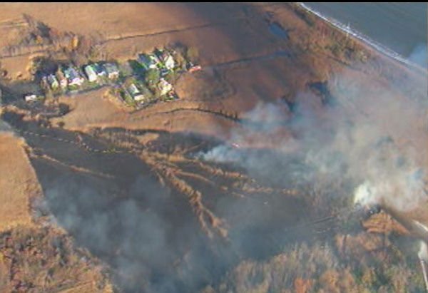 "<div class=""meta ""><span class=""caption-text "">A five alarm fire burned through brush in the Oakwood Beach section of Staten Island on Friday, November 12, 2010. (WABC Photo)</span></div>"