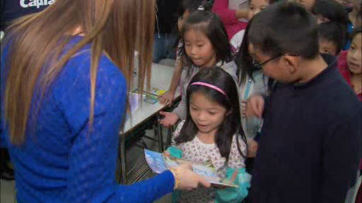 Disney Channel's Laura Marano (Austin and Ally) paid a special visit to Manhattan's PS 124 to deliver free books and read to students.