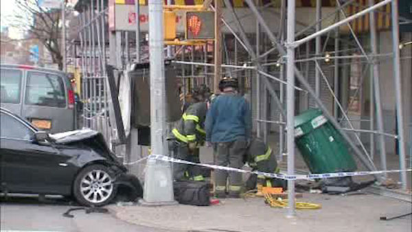 Four people were injured when two cars collided Sunday morning at Broadway and West 160th Street.  One of the vehicles then crashed into a scaffolding.