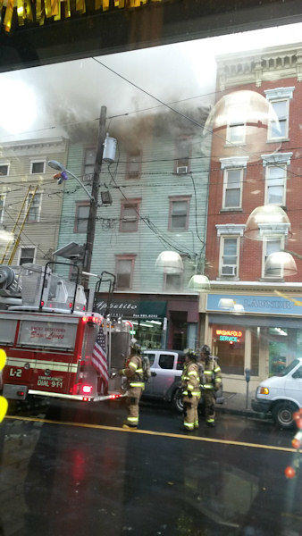 "<div class=""meta ""><span class=""caption-text "">Photos from the scene of a multi-alarm fire in Jersey City, New Jersey on Wednesday, November 27, 2013. (Photo/Nicole Cifuentes)</span></div>"