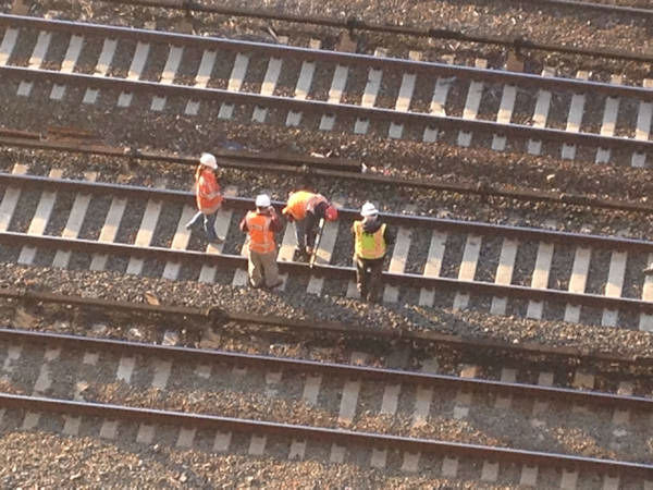 "<div class=""meta ""><span class=""caption-text "">Crews examining tracks at the scene of the Metro North derailment in the Bronx. (WABC Photo/ Rene Washington)</span></div>"
