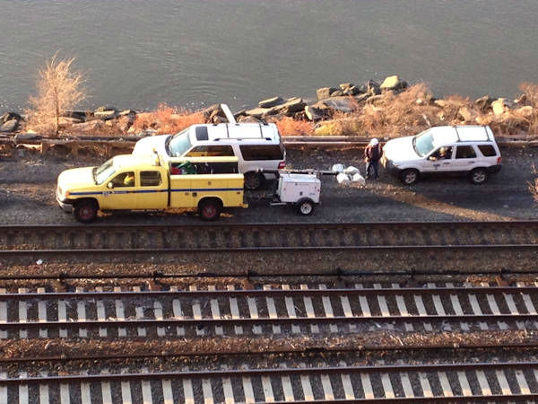 "<div class=""meta ""><span class=""caption-text "">Crews on the scene of the Metro North derailment in the Bronx (Rene Washington)</span></div>"