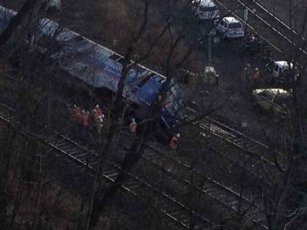 "<div class=""meta image-caption""><div class=""origin-logo origin-image ""><span></span></div><span class=""caption-text"">Crews on the scene of the Metro-North derailment on Sunday, December 1, 2013. (WABC Photo/ Renee Washington)</span></div>"