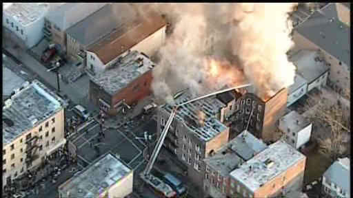 "<div class=""meta ""><span class=""caption-text "">Apartment building fire in Union City, New Jersey</span></div>"