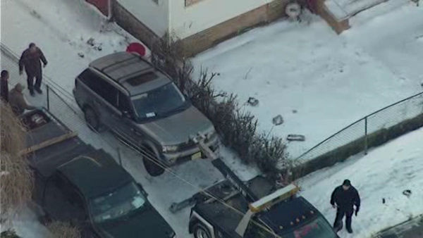 Photos from the scene in Newark, New Jersey where the victim's vehicle was found on Monday morning.