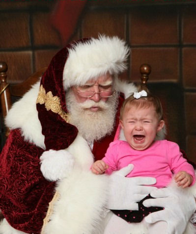 "<div class=""meta ""><span class=""caption-text ""> 10.5 months old Chloe, taken just after she pulled Santa's very real beard.</span></div>"